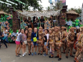 Before the Grand Parade, take a walk along Osmena Boulevard and take pictures with the performers!